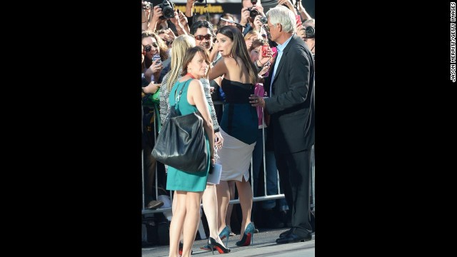 "Actress Sandra Bullock signs autographs at the ""Gravity"" premiere on September 8."