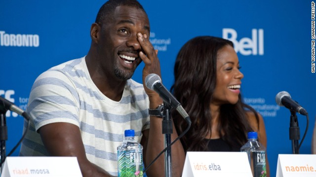 """Actors Idris Elba and Naomie Harris appear at the press conference for """"Mandela: Long Walk to Freedom"""" on September 8."""