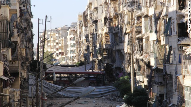 Buildings are heavily damaged in the Salah al-Din area of Aleppo on September 8.