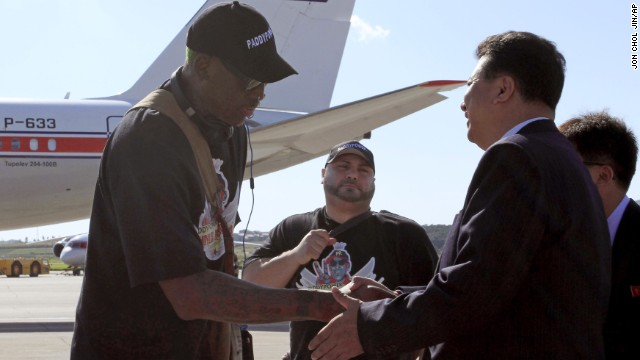 Son Kwang Ho, vice chairman of North Korea's Olympic Committee, greets Rodman at the Pyongyang airport on September 3.
