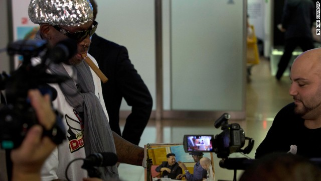 Rodman shows photos of himself with Kim while talking to journalists at the Beijing airport on September 7. In a later interview with the British newspaper The Guardian, the ex-basketball star leaked the purported name of Kim's baby daughter.