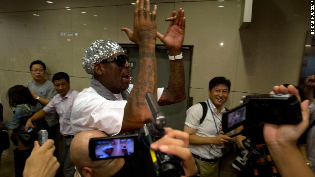 "Rodman faces questions about detained American Bae at the Beijing airport on September 7. ""It is not my job to talk about Kenneth Bae,"" he told reporters."