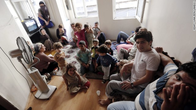 A Syrian refugee family of 26 people shares one room in the Eminonu district in Istanbul, Turkey, on September 9. The family fled Syria seven months ago.