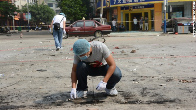 Police officers investigate a explosion scene on September 9, 2013 in Guilin, China.