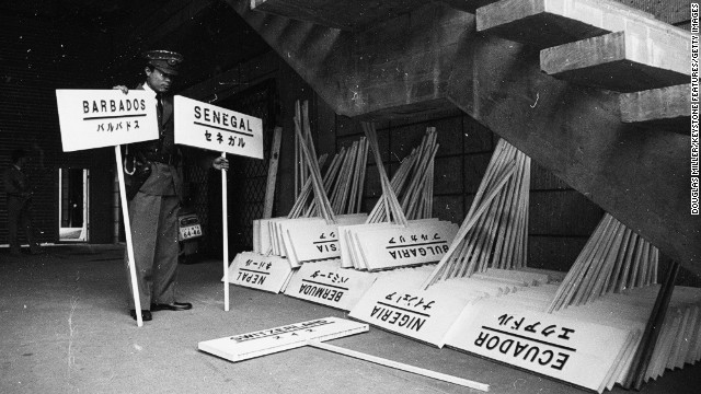 September 1964: A Japanese policeman checks the signs to be used during the opening parade.