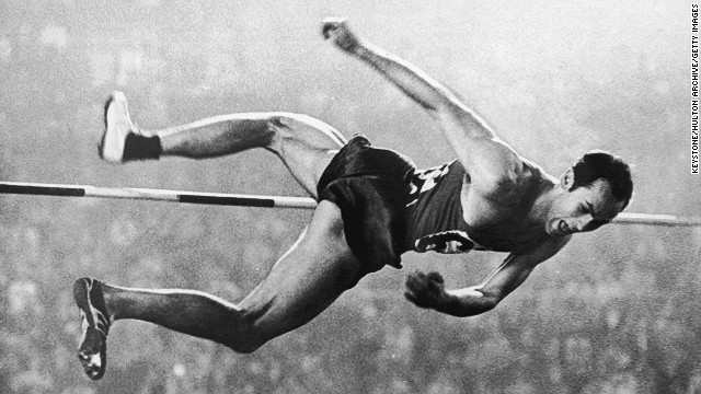 Soviet athlete Valery Brumel (1942 - 2003) clears the bar at 2.18 meters in the high jump event during on October 21, 1964. Brumel set six world records, won the silver medal in the 1960 Olympics and the gold medal at these Games.