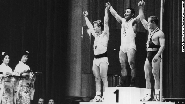 The three winners of the featherweight weightlifting event on October 14, 1964. From left to right, they are Isaac Berger of the U.S. (silver), Yoshinobu Miyake of Japan (gold) and Mieczyslaw Nowak of Poland (bronze).
