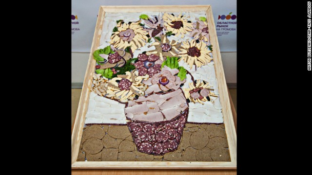 "A reproduction of van Gogh's ""Sunflowers"" made with meats and sausages is exhibited at Yekaterinburg's food market in Russia in 2012."