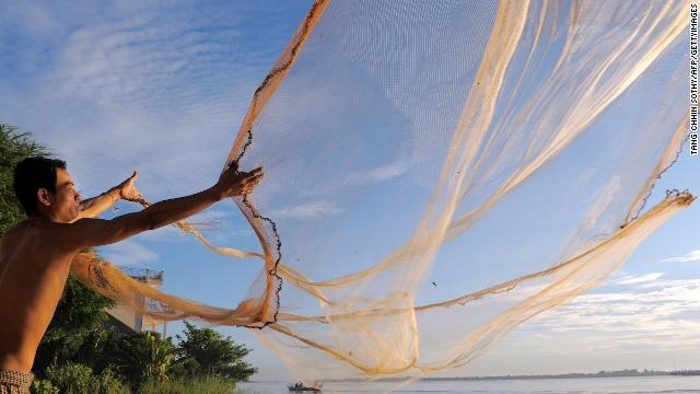 A man throws a fishing net in the Mekong river in Phnom Penh. The Cambodian capital sits at the confluence of the Tonlé Sap and Mekong rivers.