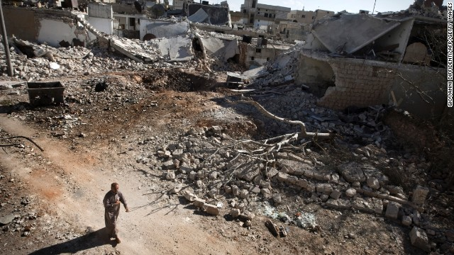 A man walks through a destroyed residential area of Saraqib, Syria, on Monday, September 9, following repeated airstrikes by government forces. More than 100,000 people have been killed in Syria since a popular uprising spiraled into a civil war in 2011, according to the United Nations. The Syrian government's suspected use of chemical weapons in a deadly August 21 attack has prompted the United States to urge military action against the regime. Click through to view the most compelling images taken since the start of the conflict.