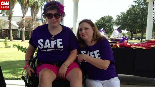 Emily strikes one of her signature faces as she poses with her mom, Tonya Bauer, at a golf tournament fundraiser for <a href='https://www.facebook.com/safe4emily' target='_blank'>SAFE</a> in August.
