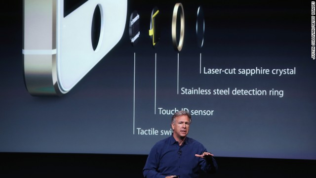 Phil Schiller talks about the new fingerprint sensor on the iPhone 5S's Home button. Called Touch ID, the system uses a sapphire crystal and capacitive touch sensor to take a high-resolution image of your fingerprint and match it with prints in its database, offering extra security if your phone falls in the wrong hands.