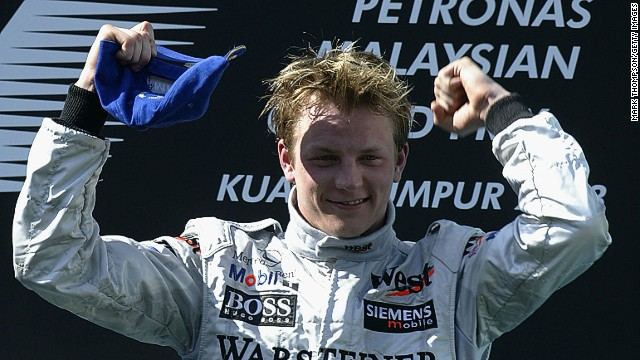 Raikkonen celebrates his maiden grand prix win in Malaysia in 2003. He had moved to McLaren, where he would spend five years, twice finishing as runner-up in the drivers' championship.