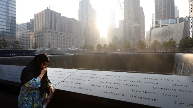 Showkatara Sharif stands next to the engraving of her daughter's name, Shakila Yasmin, at the edge of the north pool at the 9/11 Memorial in New York on September 11.