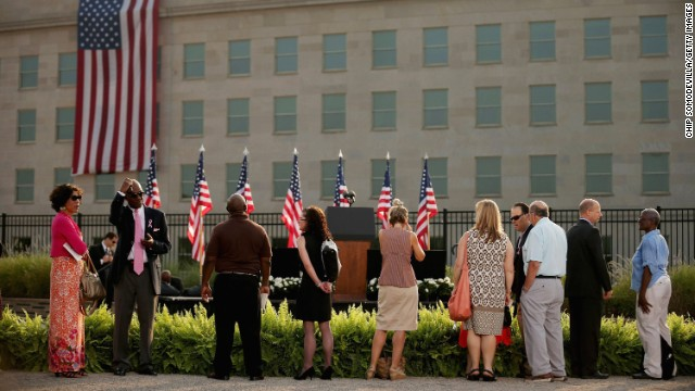 People gather in front of the Pentagon in Arlington, Virginia, before an observance ceremony on September 11.