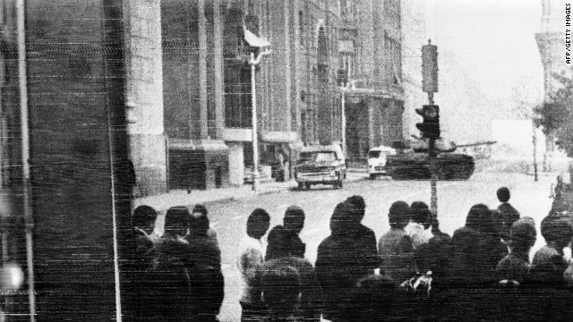Chileans watch a military tank make its way to the Presidential Palace in Santiago, on June 30, 1973. This revolt against President Allende was crushed, before Allende died in the military coup on September 11, 1973.