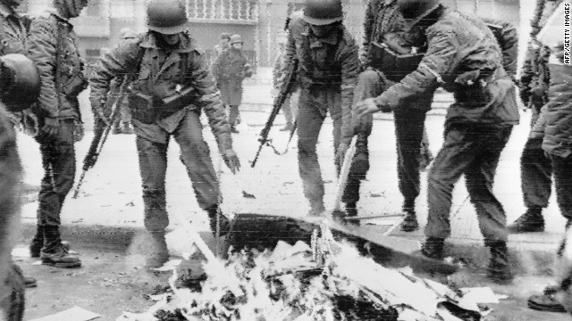 Chilean soldiers burn Marxist books in Santiago on September 26, 1973.