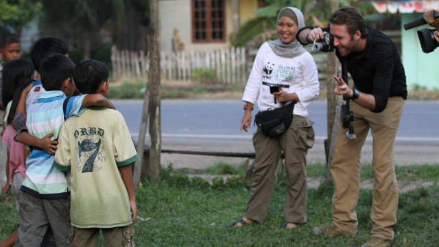 Cousteau captures a slice of local Sumatran life, taking a photo of some of the region's children.