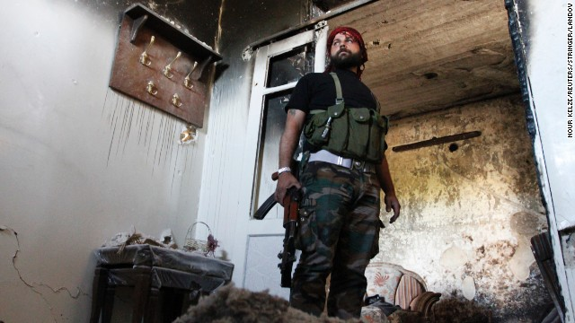 A Free Syrian Army fighter stands guard inside a damaged house in Aleppo's Qastal al-Harami neighborhood on Wednesday, September 11. More than 100,000 people have been killed in Syria since a popular uprising spiraled into a civil war in 2011, according to the United Nations. The Syrian government's suspected use of chemical weapons in a deadly August 21 attack has prompted the United States to urge military action against the regime. Click through to view the most compelling images taken since the start of the conflict.