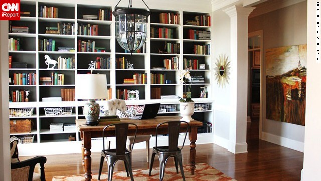 Clark's current dining room is an example of the library-dining room which is a popular option for modern dining rooms. She updates her blog from the table and can watch her children play in the house at the same time.