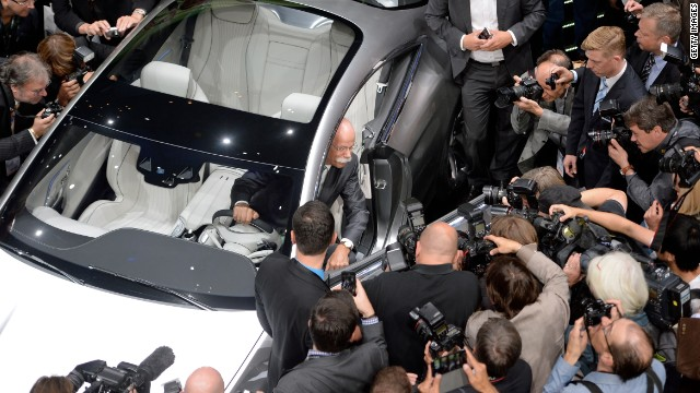 Chairman of the board of German car manufacturer Daimler AG, Dieter Zetsche, presents the new Mercedes S-Class Coupe concept car at the IAA international automobile show on September 10, 2013 in Frankfurt, Germany.