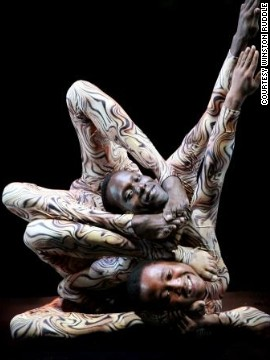 "Three years later ""Mama Africa"" was born, a circus show featuring 50 acrobats, aerialists, clowns, magicians, and of course contortionists. Here, Gitu performs with fellow contortionist Hassan Mohamed in an act called ""the Plastic Boys."""