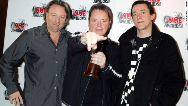 Peter Hook, Bernard Sumner and Steven Morris pose for the cameras in 2005.