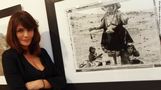 "After a career in front of the camera, Danish supermodel Helena Christensen now works behind the lens, pictured here at a 2009 London exhibition of her work. Chirstensen's photographs have appeared in fashion magazines ""Marie Claire"" and ""Elle."" The 44-year-old also recently designed a line of bags for Belgium brand Kipling."