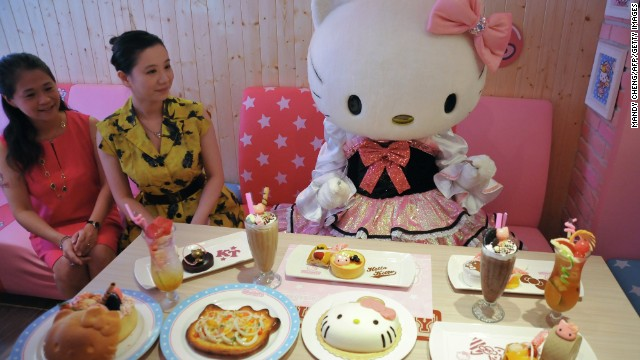 A Hello Kitty doll poses with dishes at the Hello Kitty Kitchen and Dining restaurant in Taipei on July 11, 2013. The only Taiwan Hello Kitty restaurant reopened after a month of renovations.