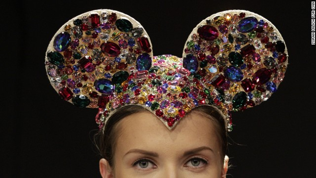 A model wears elaborately decorated mouse ears on stage at milliner Anya Caliendo's show.