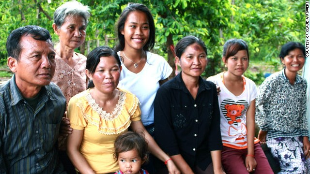 "Powers with her Cambodian family. ""The women are my mother's sisters."""