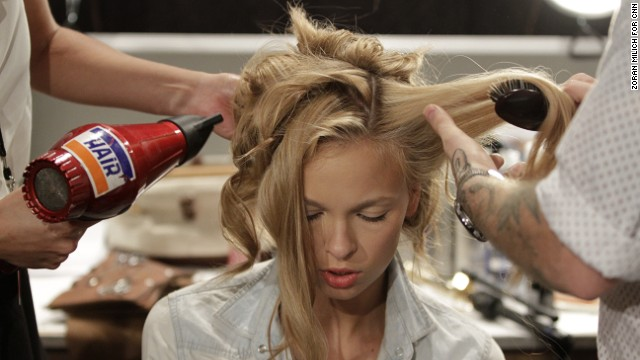 A model's hair gets pulled every which way before Marissa Web's runway show at Lincoln Center.