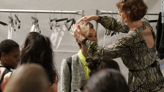 The finishing touches are put on a model's hair before she struts the catwalk for designer Marissa Webb.