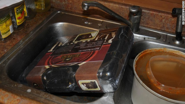 A deluxe butcher set is pictured in his sink.