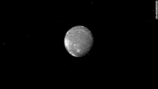 Distinct bright patches are visible on Ariel, the brightest of Uranus' five largest satellites.