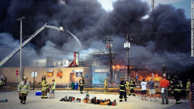 Firefighters battle the fire on the Seaside Heights boardwalk.