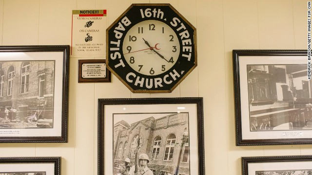 The clock that once hung in the church's sanctuary stopped at 10:22 a.m. when the bomb planted by Ku Klux Klansmen exploded 50 years ago. It is on display in the church basement, along with photographs illustrating the tensions of the era.