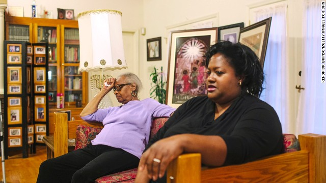 Maxine McNair, left, sits next to her daughter Kimberly McNair Brock, the younger of the two girls she had after Denise died. Kimberly was born 17 years after Denise and realizes she's spent her life being drawn to women that much older in an unconscious effort to fill a void.