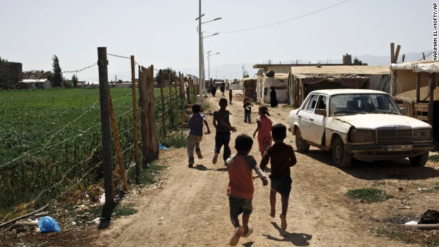 Syrian refugee children run near their tents at a temporary refugee camp near the Lebanese border with Syria on September 11.
