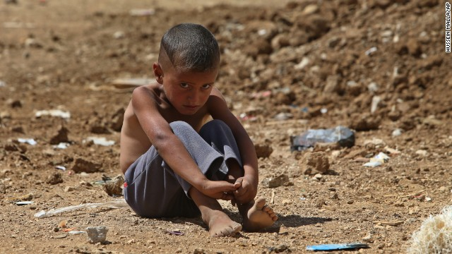 A refugee boy sits on the ground at a temporary refugee camp in the eastern Lebanese town of Al-Faour, Bekaa, on September 11.