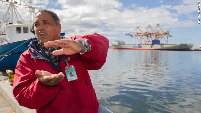 John Hernandez of Kailua, Hawaii, describes the effect that the molasses spill will have on marine life in Honolulu Harbor and nearby Keehi Lagoon on September 12. A leak in a pipeline to a Matson Navigation ship spewed as many as 1,400 tons -- 233,000 gallons -- of the sticky stuff into the water