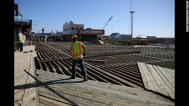 Workers constructed a new boardwalk to replace the one that was damaged by Superstorm Sandy in preparation for Memorial Day weekend.