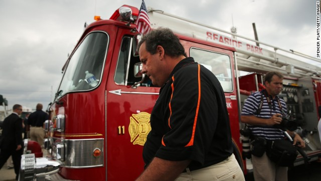 "New Jersey Gov. Chris Christie explores the fire scene in Seaside Heights, New Jersey, on September 13. ""I feel like I want to throw up,"" Christie said when he arrived at the damaged scene."