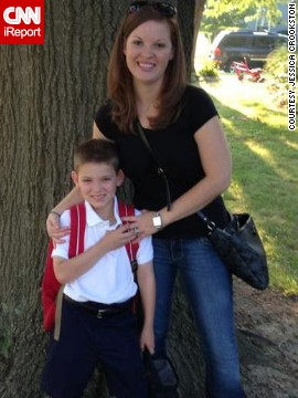 "Writer Jessica Crookston poses with her son in their yard on the first day of school this year. Samuel recently started third grade. ""Realizing that in 10 years Samuel would be starting college, I felt even more strongly that I had no desire to begin again with a baby,"" she said."
