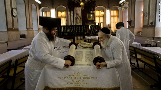 Ultra-Orthodox Jewish men roll a Torah scroll ahead of Yom Kippur in Jerusalem on September 13.