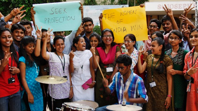 Indian students celebrate the death sentence verdict of four men who raped and murdered a woman on a bus in New Delhi last year. The students were at a gathering in Hyderabad, India, on Friday, September 13.