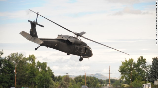 A Colorado Army National Guard helicopter takes off from the the Boulder Municipal Airport in Boulder, Colorado, on September 13.