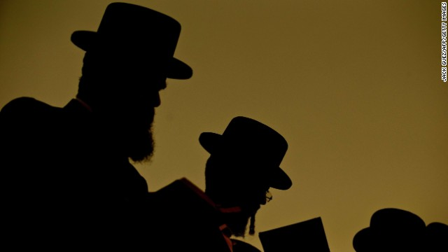 Ultra-Orthodox Jewish men pray along the Ayarkon River in the city of Ramat Gan near Tel Aviv on September 12.