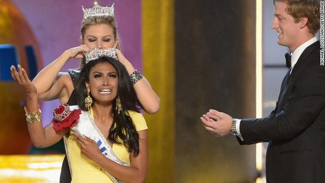 Nina Davuluri, representing New York, is crowned 2014 Miss America by 2013 Miss America Mallory Hagan.