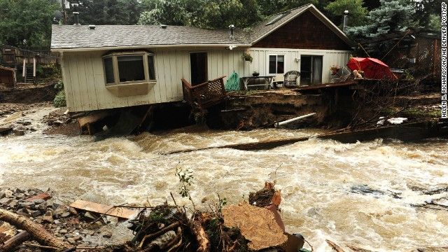 Floodwaters surround a home in Jamestown, Colorado, on Sunday, September 15.